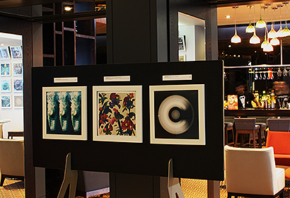 white frames for vinyl records mounted on a free standing display easel in a hotel reception